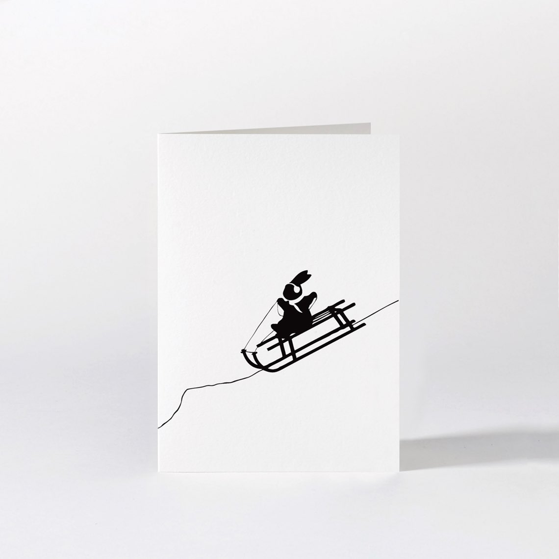 Sledging Rabbit Christmas Card